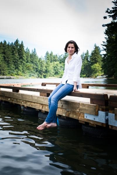 Sitting on dock smiling